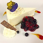 Lemon Cheesecake with mixed berry coulis