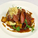 Barbary duck breast, dauphinoise potato, celeriac puree & roast root vegetable gravy