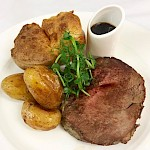 Prime roast rib of beef with homemade Yorkshire pudding, potatoes & rich Merlot gravy (available on Sundays only)