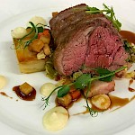 Roast rump of lamb with pancetta & savoy cabbage, honey roasted vegetables, pomme Anna & rosemary jus