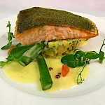 Fillet of salmon with soft herb crust, crushed potatoes, buttered asparagus & herb butter sauce
