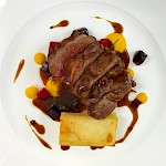Seared lamb rump with dauphinoise potato, carrot & honey puree, confit of assorted beetroot & roasting jus